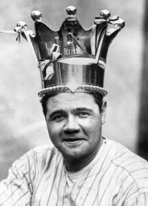 """Original caption: New York: In the Yankee clubhouse at the Polo Grounds this afternoon, George Herman """"Babe"""" Ruth was crowned the """"King of Swat,"""" Miller Huggins placing the silver crown valued at $600 on """"Babe's"""" worthy brow. """"King Ruth"""" is the inscription on the crown. The crown stands more than one foot in height, its lower rim that fits over Ruth's forehead is studded with a row of 49 engraved miniature baseballs. October 13, 1921 Manhattan, New York, New York, USA"""